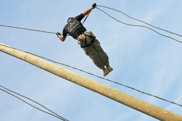 U.S. Army Staff Sgt. Kevin Serna, of San Marcos, Texas, a Phase 1 team chief at the Fort Hood Air Assault School, rappels from the 50-foot rappel tower at the air assault obstacle course, May 7, 2014. Air Assault School qualifies Soldiers to conduct airmobile and air assault helicopter operations, to include aircraft orientation, sling load operations, proper rappelling techniques and fast-rope techniques. The school itself is 10 days of rigorous, fast paced training. The high standards of the school require the student to take part in a 12-mile march with rucksack in under three hours on the morning of graduation to be awarded their wings. Iterations of the FHAAS begin with 132 students, and end with an average of 80 graduates. (U.S. Army photograph by Sgt. Ken Scar, 7th Mobile Public Affairs Detachment)