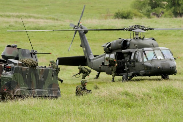 Lithuanian Soldiers conduct an air assault with 3rd Battalion, 158th Aviation Regiment during urban assault training on Hohenfels Army base during the multi-national training exercise, Combined Resolve II (U.S. Army photo by Capt. John Farmer, 1st BCT, 1st CD Public Affairs).