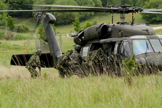 Lithuanian Soldiers evacuate casualties in a UH-60 Blackhawk with 3rd Battalion, 158th Aviation Regiment after urban assault training on Hohenfels Army base during the multi-national training exercise, Combined Resolve II (U.S. Army photo by Capt. John Farmer, 1st BCT, 1st CD Public Affairs).