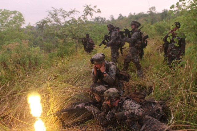 Philippine soldiers from Charlie Company, 20th Infantry Battalion, 8th Infantry Division, and U.S. Soldiers from Comanche Troop, 3rd Squadron, 4th Cavalry Regiment, 25th Infantry Division, engage enemy targets with blank rounds during a battalion field training exercise as the culminating event for Balikatan 2014, May 15, 2014, at Fort Ramon Magsaysay, Philippines.