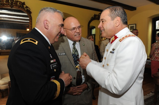CARLISLE BARRACKS, Pa. -- (Left to right) Brig. Gen. Orlando Salinas, U.S. Army South deputy commander, Bob Pelegreen, Army South Security Cooperation Division deputy chief and Gen. Humberto Oviedo, Chilean Army commander, visit with each other prior to the start of a ceremony at the U.S. Army War College here May 12. During the ceremony, Oviedo became the 48th member of the U.S. Army War College International Fellows Hall of Fame and the first from a South American country.