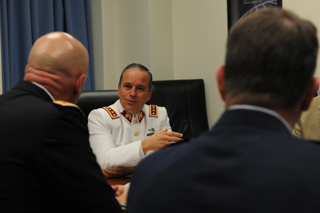 CARLISLE BARRACKS, Pa. -- Gen. Humberto Oviedo, Chilean Army commander, meets with members of the U.S. Army War College staff here May 12. Oviedo traveled to Carlisle Barracks, Pa. to take part in a ceremony in which he became the 48th member of the U.S. Army War College International Fellows Hall of Fame and the first from a South American country.
