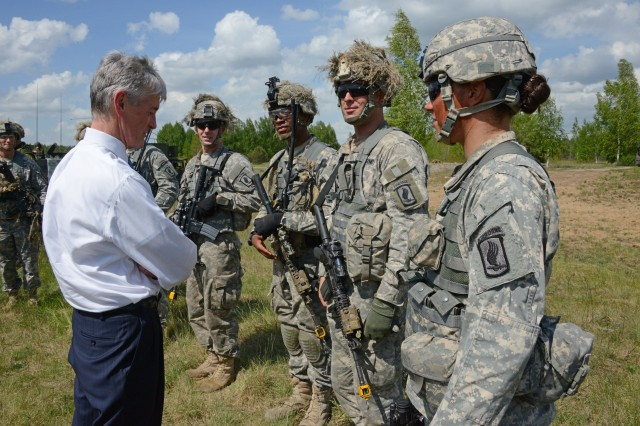 """Secretary of the Army John M. McHugh discusses mission importance with paratroopers of the 1st Battalion, 503rd Infantry Regiment, 173rd Airborne Brigade, in Ruka, Lithuania, May 18, 2014. The """"Sky Soldiers"""" from the 173rd are participating in exercise Black Arrow alongside the Lithuanian """"Iron Wolf"""" Mechanized Brigade, a training event designed to increase NATO interoperability between the two forces."""