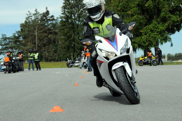 Sgt. Christian Marchand, Fire Squadron, Bravo Battery, 2nd Cavalry Regiment, navigates the slow slalom during Motorcycle Safety Day, May 16.