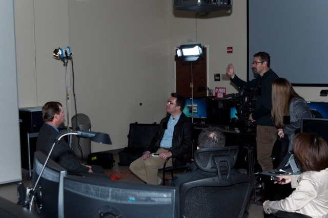 Inside the Redstone Test Center's Flight Test Control Center, Fox News reporter Jonathan Serrie, seated right, interviews a contractor representative about the capabilities of the M-DSA.