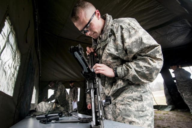Pfc. Gregory Doty, of Lake Peekskill, N.Y., with the 854th Engineer Battalion, works to assemble the M240B and M249 machine guns in under four minutes during a mystery event during the 412th and 416th Theater Engineer Commands' combined regional Best Warrior competition held at Fort McCoy, Wis., April 29. (U.S. Army photo by Sgt. 1st Class Michel Sauret)