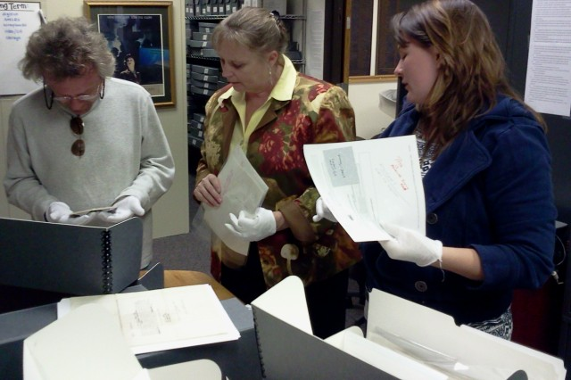 Francoise Bonnell, U.S. Army Women's Museum director, center, and Amanda Strickland, museum archivist, provided Unsung Heroes' writer and director Frank Martin never-before published materials for the documentary in October 2012. The project was two years in the making, and will begin airing on Public Broadcasting Service stations starting the last week of May. (U.S. Army photo by Keith Desbois)