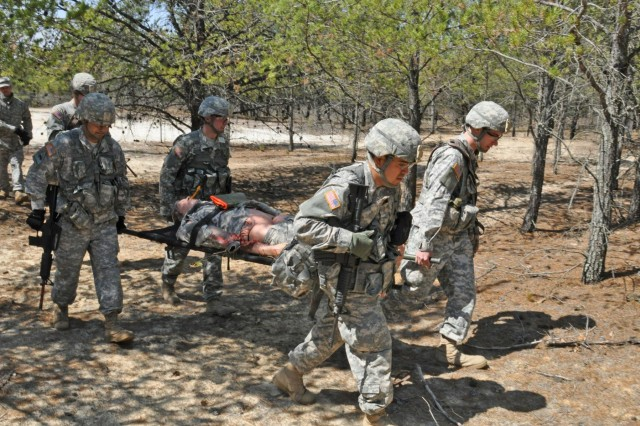 Staff Sgt. Billy Daffron, St. Joseph, Mo., Pfc. Jonathan Doolan, Kansas City, Mo., Spc. Antonio Munoz, Kansas City, Mo., and Spc. Kyle Malone, Kansas City, Mo., with the 348th Engineer Company conduct medical evacuation procedures by evaluating and providing aid to a casualty that includes stabilizing and evacuating a casualty during the 2014 Sapper Stakes that pits engineer unit teams against each other as they vie to win the inaugural competition.