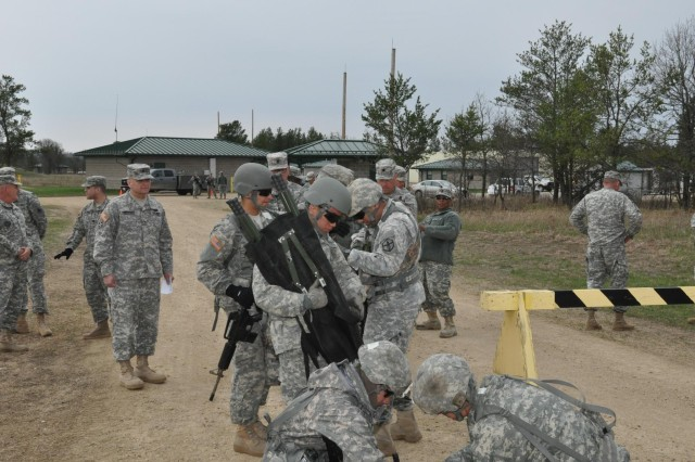 Brig. Gen. Anthony C. Funkhouser, the Commandant of the U.S. Army Engineer School, reviews participants competing in the casualty evacuation event during the 2014 Sapper Stakes in its inaugural year at Fort McCoy, Wis., May 7.