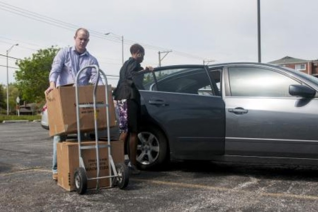 Andrew Jones, the sexual assault response coordinator for the 416th Theater Engineer Command, and resident of Plainfield, Ill., and Camille Kent, of Lisle, Ill., the victims advocate for the 416th TEC, unload boxs of donated clothes at Pillars, a community social service agency that tailors to people with various needs, to include domestic and sexual violence victims, in Hickory Hills, Ill., May 19. The clothes were donated by Reserve Soldiers as part of a clothing drive initiative during April, known nationally as Sexual Assault Awareness Month. (U.S. Army photo by Sgt. 1st Class Michel Sauret)