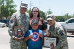 CSM  Akuna presents certificate to young fan of DivWest