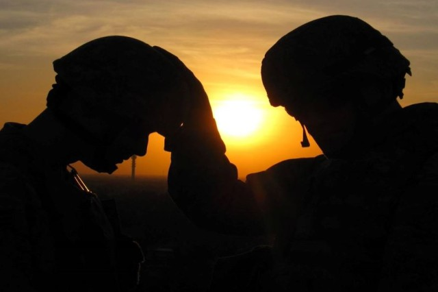 Chaplain Prayers with Soldier