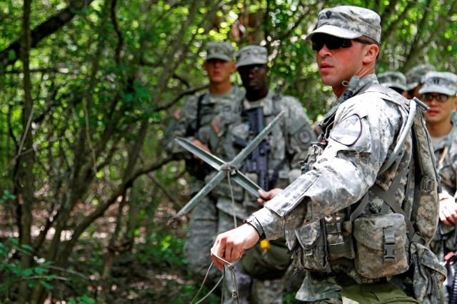 "Spc. Joseph Giardina, a Phoenix native and combat medic assigned to Troop A, 1st Squadron, 7th Cavalry Regiment ""Garryowen,"" 1st Brigade Combat Team ""Ironhorse,"" 1st Cavalry Division, prepares to throw a simulated grapnel hook during training for the Expert Field Medical Badge May 14 at Fort Hood, Texas. Along with tasks specific to medical military occupational specialties, EFMB candidates must prove proficiency in a range of basic Soldier skills to earn the badge. (U.S. Army photo by Spc. Paige Behringer, 1BCT PAO, 1st Cav. Div.)"