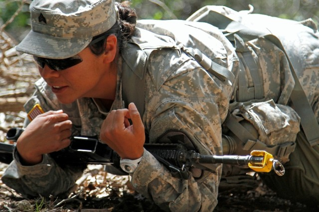 """Sgt. Cindy Rojas, a Salinas, California, native and combat medic assigned to the 91st Brigade Engineer Battalion """"Saber,"""" 1st Brigade Combat Team """"Ironhorse,"""" 1st Cavalry Division, demonstrates a high-crawl during training for the Expert Field Medical Badge May 14 at Fort Hood, Texas. EFMB tasks are a combination of field medical proficiency and basic Soldier skills. (U.S. Army photo by Spc. Paige Behringer, 1BCT PAO, 1st Cav. Div.)"""