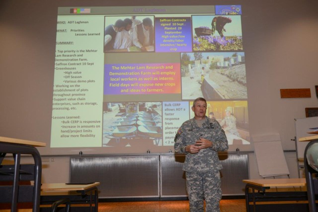 Brig. Gen. Eric Peck, commander of ground forces for the Kansas National Guard, addresses the Agribusiness Development Team mission in Afghanistan during a presentation to Special Operations Forces at the International Special Training Center in Pfullendorf, Germany, May 13.