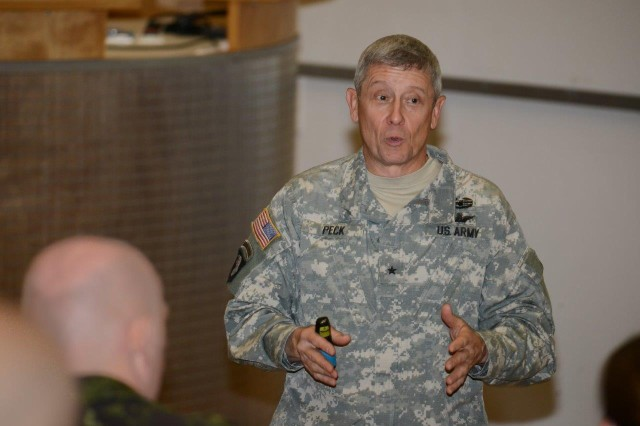 Brig. Gen. Eric Peck addresses an international contingent of Special Operations Forces during a presentation at the Joint Multinational Training Center's International Special Training Center in Pfullendorf, Germany, May 13.