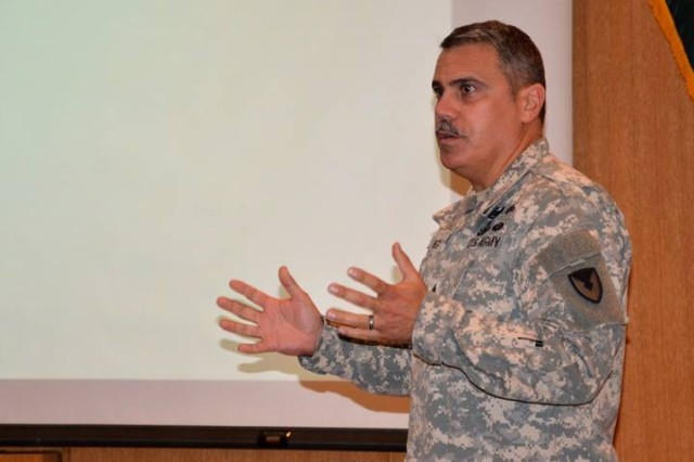 Command Sgt. Maj. David M. Puig speaks to contracting members during an Army Contracting Command town hall May 20 at Joint Base San Antonio-Fort Sam Houston, Texas.