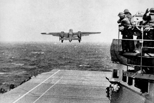 "One of the Doolittle B-25 aircraft takes off from the deck of the USS Hornet in April 1942, to bomb mainland Japan. Lt. Gen. Raymond V. Mason, deputy chief of staff, G-4, said at the beginning of World War II, the Army did some out-of-the-box thinking. B-25s were stripped down to conserve fuel and were sent to bomb mainland Japan in the Doolittle Raid. Mason spoke at AUSA's ""Sustaining Force 2025"" seminar in Arlington, Va., May 20, 2014."