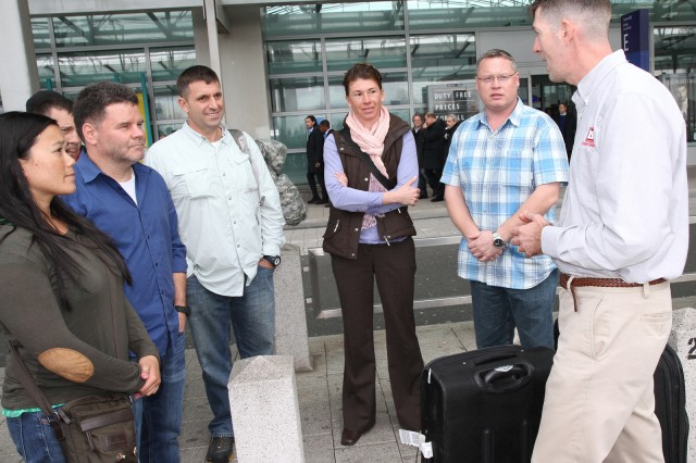 Col. Peter Helmlinger, the U.S. Army Corps of Engineers Europe District commander, greets the Forward Engineer Support Team-Advanced on Feb. 26 at Frankfurt Airport as the members arrived home in Germany following a six-month deployment to Jordan.