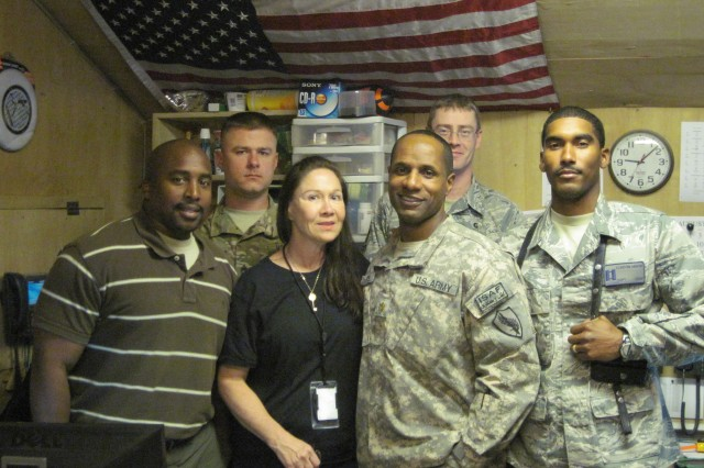 Delores Peshoff is a Deployed Cadre Program member who deployed to Afghanistan in 2011 and is currently redeployed. With her are (left to right) Kip Ryan, Staff. Sgt. Michael McCue, Maj. Blain A White, U.S. Air Force Master Sgt. Christopher Klaasen and U.S. Air Force Capt. Clinton T. Minor.