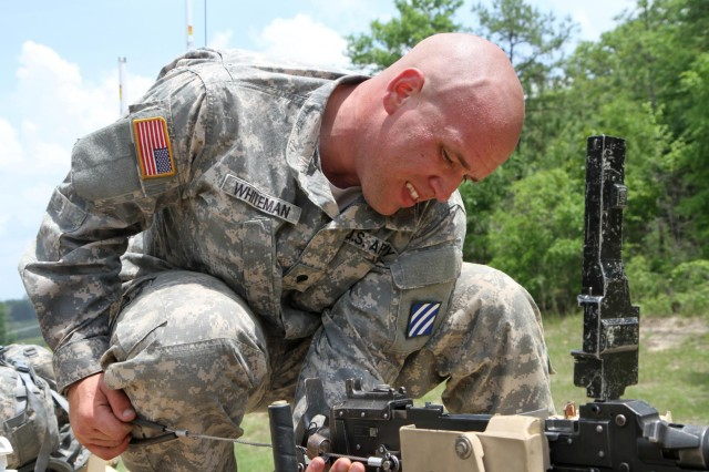 Townsend, Del., native Spc. Benjamin Whiteman, a loader with 2nd Battalion, 69th Armor Regiment, loads a  weapon, May 12, during the 2014 Sullivan Cup Best Tank Crew Competition. Four Soldiers from Company C, 2nd Bn., 69th Armor Regt., 3rd Armored Brigade Combat Team, 3rd Infantry Division, competed in the 2014 Sullivan Cup Best Tank Crew at Fort Benning, Ga. The weeklong event, from May 12-15, tested the Soldiers in a variety of armor tank crew core competencies using a physical challenge, gunnery and offensive and defensive maneuvering with the Closed Combat Tactical Trainer. The 2nd Bn., 69th Armor Regt. was named the best tank crew in a ceremony May 15.