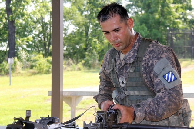 Sgt. Kevin Luu, a gunner with 2nd Battalion, 69th Armor Regiment, from Tioga, N.Y., works with his weapon, May 12, during the 2014 Sullivan Cup Best Tank Crew Competition. Four Soldiers from Company C, 2nd Bn., 69th Armor Regt., 3rd Armored Brigade Combat Team, 3rd Infantry Division, competed in the 2014 Sullivan Cup Best Tank Crew at Fort Benning, Ga. The weeklong event, from May 12 to 15, tested the Soldiers in a variety of armor tank crew core competencies using a physical challenge, gunnery and offensive and defensive maneuvering with the Closed Combat Tactical Trainer. The 2nd Bn., 69th Armor Regt. was named the best tank crew in a ceremony May 15.