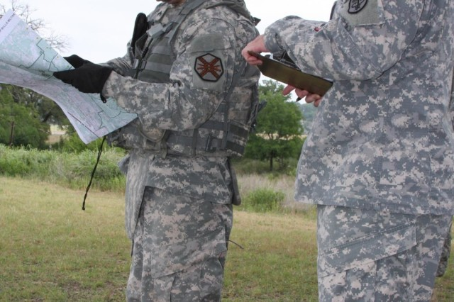 Cpl. Ryan Perea, U.S. Army Garrison Fort Bragg, demonstrates his ability to identify geographic features on a map during the land navigation portion of the U.S. Army Installation Management Command Best Warrior Competition, May 6, at Joint Base San Antonio-Camp Bullis. (U.S. Army photo by Amanda Kraus Rodriguez)