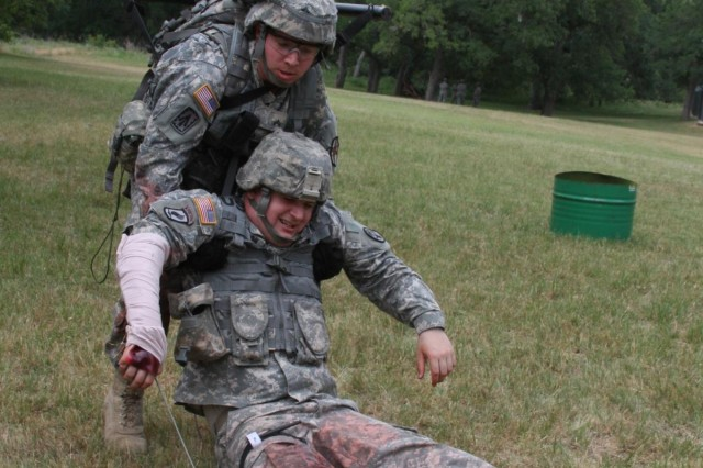 Cpl. Ryan Perea, U.S. Army Garrison Fort Bragg, pulls a fellow Soldier to safety - a critical element of the U.S. Army Installation Management Command Best Warrior Competition tasks and drills, May 6, at Joint Base San Antonio-Camp Bullis. (U.S. Army photo by Amanda Kraus Rodriguez)