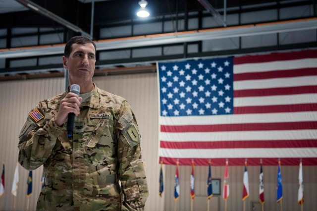 Col. Matthew Lewis, the commander of the 1st CAB, 1st Inf. Div., addresses the brigade's last five Soldiers to return from Afghanistan May 12, during a final redeployment ceremony. The brigade has hosted more than 15 redeployment ceremonies since mid-April to welcome home Soldiers.