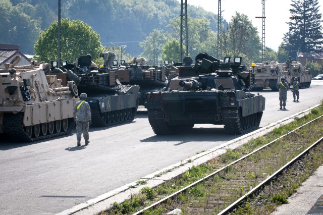 U.S. Army Soldiers from the 2nd Battalion, 5th Cavalry Regiment, 1st Brigade Combat Team, 1st Cavalry Division, offload tanks at the Parsberg, Germany, railhead, May 6, 2014.  The armored vehicles are part of the European Activity Set, a battalion-sized set of equipment pre-positioned on the Grafenwoehr Training Area to outfit and support U.S. Army forces rotating to Europe for training and contingency missions in support of the U.S. European Command.  The European Activity Set will be used for the first time by the 1st Brigade Combat Team, 1st Cavalry Division during exercise Combined Resolve II at the U.S. Army's Grafenwoehr and Hohenfels Training Areas,from May 15 to Jun. 30, 2014.