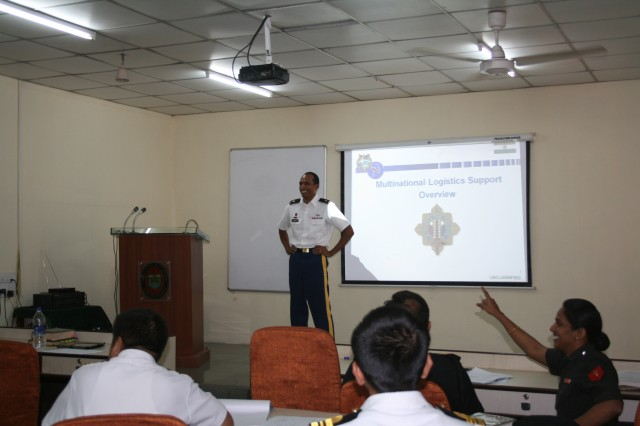 Maj. Marlin Paschal,413th Contracting Support Brigade command judge advocate, discusses Army contracting during a military-to-military exchange training session between the U.S. and India at the Indian Institute of Military Law at Kamptee Cantonment Area, India.