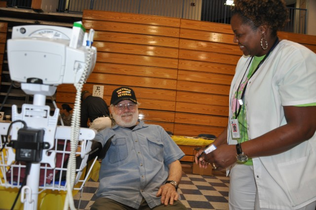 Vietnam veteran Linton Jeter has his blood pressure checked by registered nurse Tameshia Spain during a Retiree Health and Benefits Expo at Fort Jackson's Solomon Center May 17, 2014.