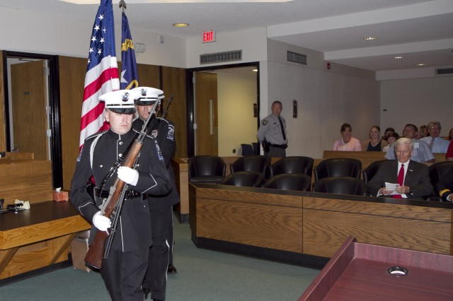The Mooresville Police Department Color Guard enters the court room during for the presentation ceremony where Maj. Gen. Gill Beck, commanding general of the 81st Regional Support Command, awarded the Bronze Star Medal to Col. Joseph Crosswhite at the Hall of Justice in Statesville, North Carolina on May 17. Crosswhite served a tour in Afghanistan as an advisor to Aghan prosecutors and judges. Crosshwhite served as the Staff Judge Advocate for the 81st prior to his deployment and is currently the Chief of International and Operational Law at Army Forces Command at Fort Bragg, N.C.