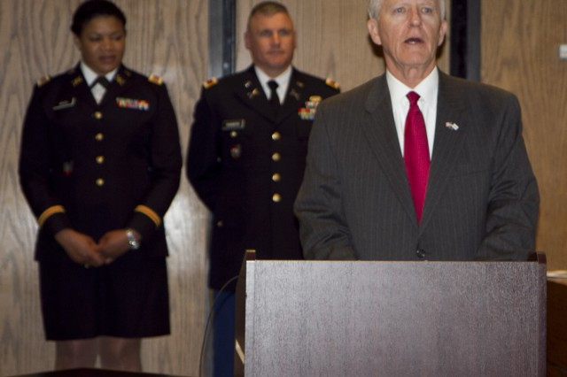 Ron Bogle, chairman of the North Carolina ESGR Committee, addresses the audience just after the presentation ceremony where Maj. Gen. Gill Beck, commanding general of the 81st Regional Support Command, awarded the Bronze Star Medal to Col. Joseph Crosswhite at the Hall of Justice in Statesville, North Carolina. Crosswhite served a tour in Afghanistan as an advisor to Aghan prosecutors and judges. Crosshwhite served as the Staff Judge Advocate for the 81st prior to his deployment and is currently the Chief of International and Operational Law at Army Forces Command at Fort Bragg, N.C.