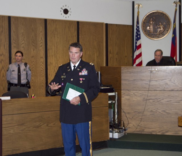 Bronze Star Medal presented to Army Reserve lawyer and judge in his civilian courtroom