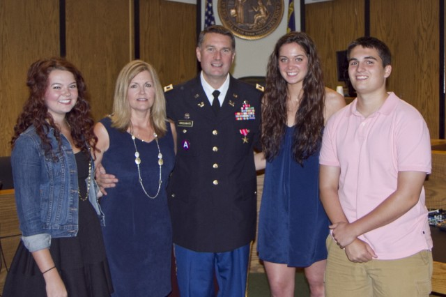 Col. Joseph Crosswhite and his family just after the presentation ceremony where he received the Bronze Star Medal at the Hall of Justice in Statesville, N.C. Crosswhite served a tour in Afghanistan as an adviser to Afghan prosecutors and judges. Crosshwhite served as the staff judge advocate for the 81st prior to his deployment and is currently the chief of International and Operational Law at U.S. Army Forces Command at Fort Bragg, N.C.
