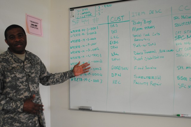 Sgt. 1st Class Kevin A. McClatchey, contract specialist, 926th Contingency Contracting Battalion, presents his team's completed contracting actions during a military exercise STORMEX held May 14-16 at Aberdeen Proving Ground, Maryland.  The team prepared letter contracts, purchase orders and completed a Standard Form 44 for a micro-purchase. (Photo by Betsy Kozak-Howard)