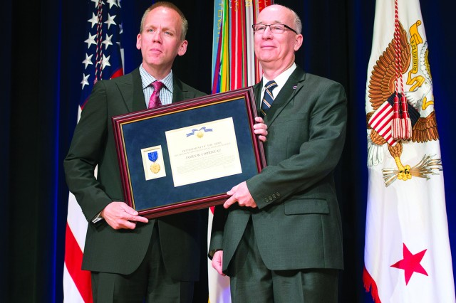 Under Secretary of the Army Brad R. Carson, left, presents Corriveau with the Decoration for Exceptional Civilian Service during the 2014 Secretary of the Army Awards ceremony May 5 at the Pentagon.
