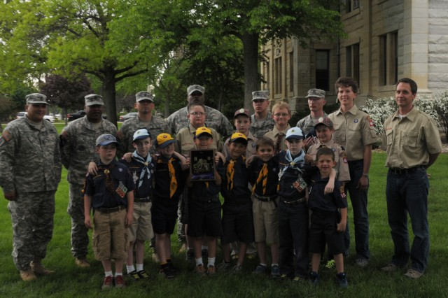 Soldiers from First Army and scouts from Cub Scout Pack 2664 gather after a flag folding practice session on the Rock Island Arsenal for the evening's retreat ceremony on May 20.