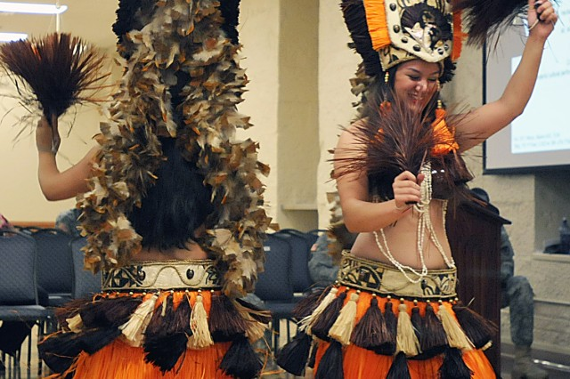 Dancers from the Aloha Chicago Entertainment perform in costume a few Asian/Pacific-styled musical selections during the Asian-American Pacific Islander  Heritage Month observance May 21 at Rock Island Arsenal, Ill. (Photo by Jon Micheal Connor, U.S. Army Sustainment Command Public Affairs)