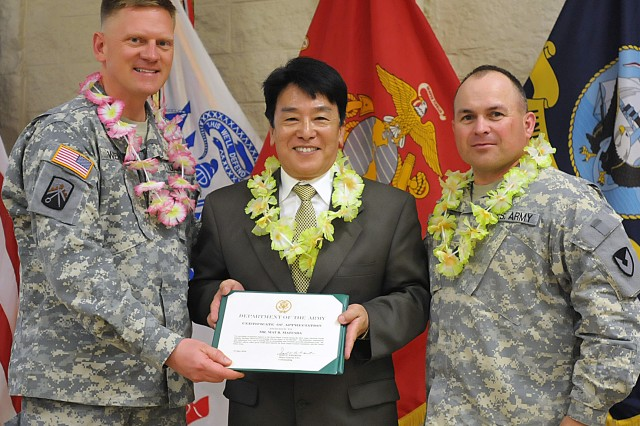 Col. Darren Werner (left), chief of staff, U.S. Army Sustainment Command, and Command Sgt. Maj. James Spencer, ASC, present Mat Matsuda with a certificate of appreciation for his participation in the observance.