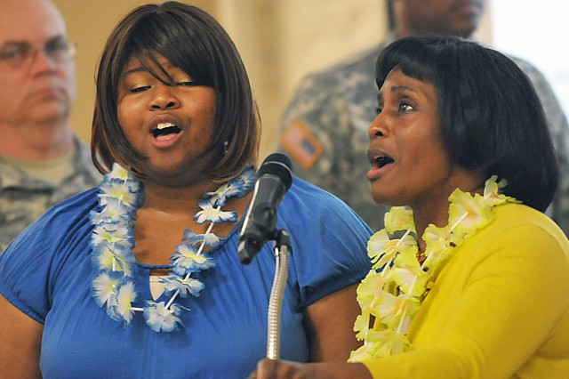 Jereen Phillips-Hardin (left) and Everline Barnard, U.S. Army Sustainment Command employees, sing the national anthem during the Asian-American Pacific Islander Heritage Month observance May 21 at Rock Island Arsenal, Ill. (Photo by Jon Micheal Connor, U.S. Army Sustainment Command Public Affairs)