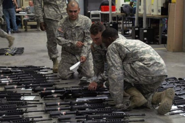 Soldiers at Fort Riley, Kan., take a look at their new M4-A1 carbines.