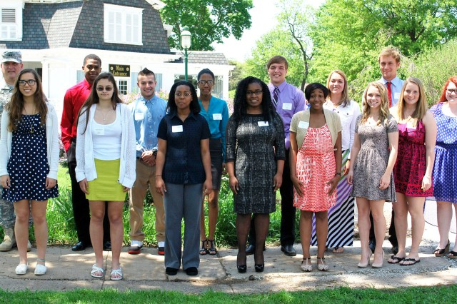 The Rock Island Arsenal Welcome Club honored 17 college-bound students with scholarships during a luncheon at the Rock Island Arsenal Golf Clubhouse May 21.  Scholarships were awarded in the amounts of $1,000 to $1,500.  Front row, from left: Jacqueline Colarusso, Robin Murphy, Janita Pegram, Keiana Holleman, Breyana Williams, Jessica Green, Abigail Perry, and Mackenzie Donahue.  Back row, from left: Maj. Gen. John Wharton, Kenyon Thomas, Neko Bessera, Amani Kirby, Nicholas Niles, Morgan Murphy, and Ryan Blunk.  Scholarship recipients not pictured: Ashley Beausoleil, Megan Beck, and Anthony Pham. (Photo by Maj. Yokeitha Ramey, ASC Public Affairs)
