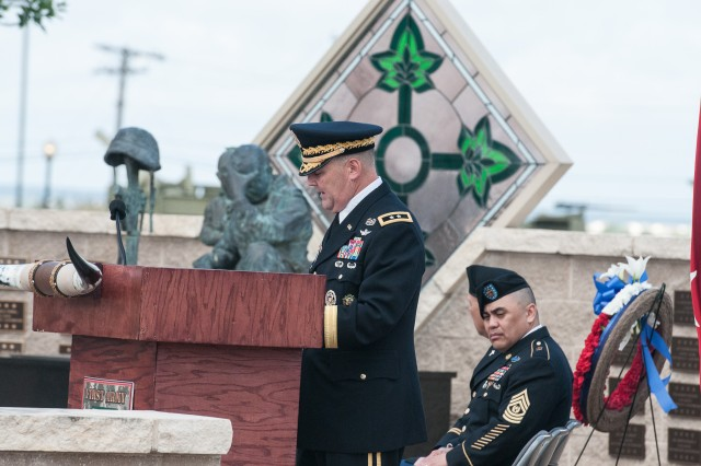 Maj. Gen. Warren E. Phipps, Jr., center, First Army Division West commanding general gives a speech on the significance of Memorial Day at the 4th Infantry Division Memorial on Cameron Field near First Army Division West headquarters on Fort Hood, Texas, May 21. Phipps tells the gathering of Soldiers, Families and civilians to remember those who paid the full measure for their freedom. (Photo by Staff Sgt. Tony Foster, Division West Public Affairs)