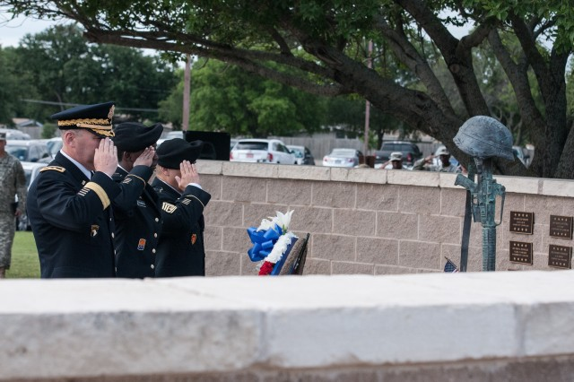 Maj. Gen. Warren E. Phipps, Jr., left, First Army Division West commanding general, Sgt. Britny Drummond, center, and Division West Command Sgt. Maj. Patrick K. Akuna, Jr., render salutes to honor fallen servicemembers at the 4th Infantry Division Memorial on Cameron Field near First Army Division West headquarters on Fort Hood, Texas, May 21. (Photo by Staff Sgt. Tony Foster, Division West Public Affairs)