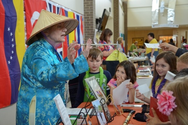 Sylvia Crawford, Barsanti Elementary student council and gifted resource teacher, teaches a group of students how to say hello in Vietnamese during the school's second annual International Day, May 16. The event showcased a variety of cultures, displaying items such as books, pottery, maps and food samples.