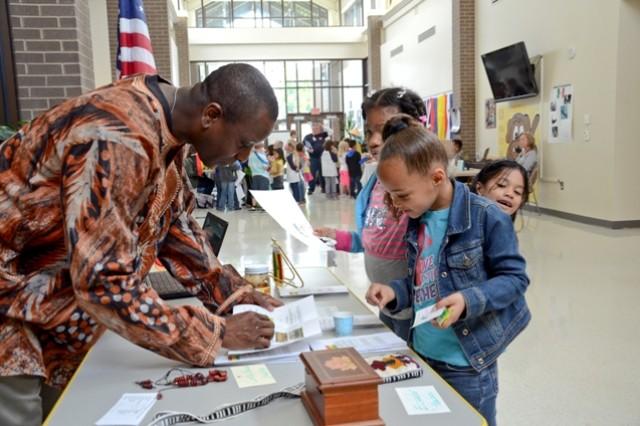 Specialist Anthony Amonoo, Company B, 2nd Battalion, 320th Field Artillery, 1st Brigade Combat Team, 101st Airborne Division, shares some information about his birth country, Ghana, with students during the second annual Barsanti Elementary School International Day, May 16.