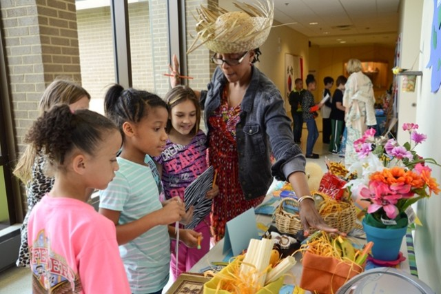 Oxendine, a reading specialist at Barsanti Elementary School, talks to a group of students about the Caribbean Islands during the school's second annual International Day, May 16.