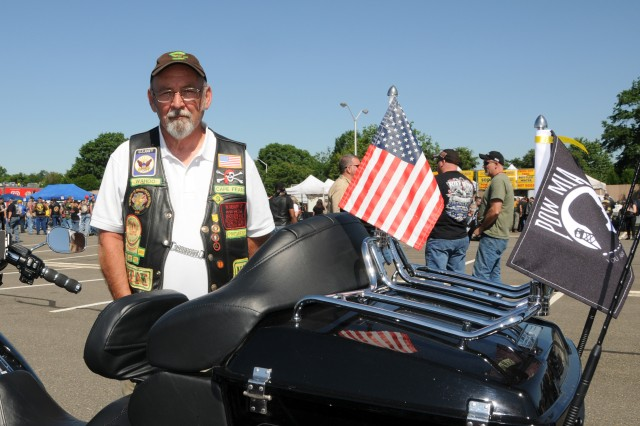 """Keith Sellers, a U.S. Navy veteran of the Vietnam War, participated in the 27th annual Rolling Thunder Motorcycle rally in support of POWs and MIAs.  At the Pentagon in Arlington, Va., tens of thousands of motorcyclists gathered to participate in the 27th """"Rolling Thunder"""" motorcycle rally, May 25, 2014. The event is in its 27th year now. Participants from around the United States gathered at the Pentagon before embarking on a ride around the National Mall in Washington, D.C. The rally brings attention to prisoners of war and those missing in action."""